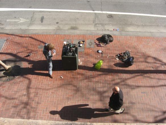 street hippie rolling a blunt