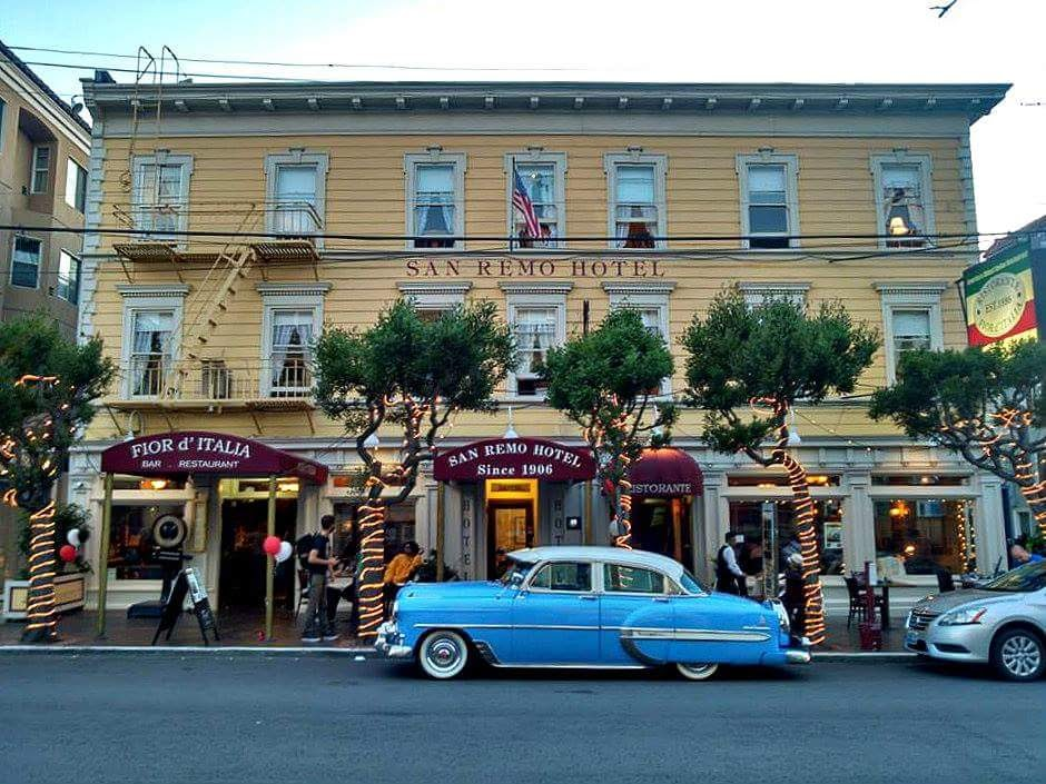Oldest Italian restaurant with attached hotel and vintage car in front