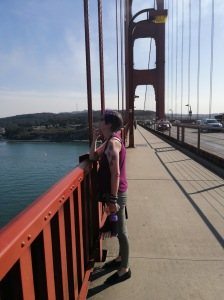 My life partner looks towards SF from Golden Gate Bridge with the South Tower in view.